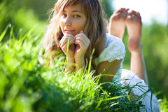 Young woman lying on grass Royalty Free Stock Image