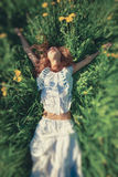 Young woman lying on grass Royalty Free Stock Photo