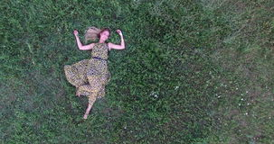 Young woman lying in grass stock video