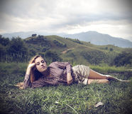 Young woman lying on the grass Stock Photo