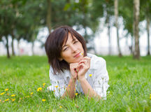 Young woman lying on the grass Royalty Free Stock Images