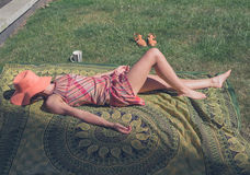 Young woman lying on the grass outside Royalty Free Stock Photography