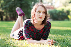 Young woman lying on the grass Stock Photography