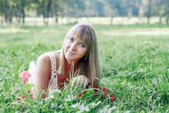 Young woman lying on the grass Royalty Free Stock Photo