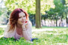 Young woman lying on the grass Royalty Free Stock Image