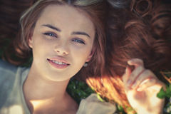 Young woman lying on grass portrait Royalty Free Stock Photography