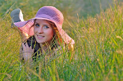 Young woman lying in grass Royalty Free Stock Images