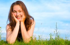 Young woman lying on the green grass Royalty Free Stock Photo