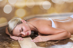 Young woman lying on hammam table in turkish bath Royalty Free Stock Image