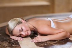 Young woman lying on hammam table in turkish bath Royalty Free Stock Photography