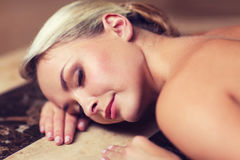 Young woman lying on hammam table in turkish bath Royalty Free Stock Images