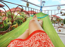 Young woman lying in a hammock. Woman lying in a hammock Stock Image