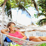 Young woman lying in hammock.  Stock Photos