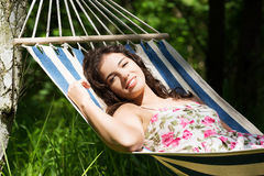 Young woman lying in a hammock Royalty Free Stock Photos