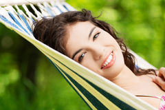 Young woman lying in a hammock Royalty Free Stock Images