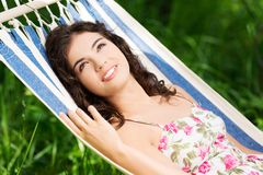 Young woman lying in a hammock Stock Photos