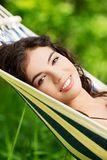 Young woman lying in a hammock Stock Images