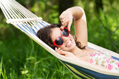 Young woman lying in a hammock Stock Photo