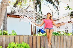 Young woman lying in a hammock near a beach.  Royalty Free Stock Images