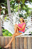 Young woman lying in a hammock near a beach.  Royalty Free Stock Photos