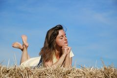 Young woman lying in hay Royalty Free Stock Photography