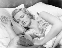 Young woman lying in her bed sleeping Stock Photos