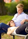 Young Woman Lying on Her Boyfriend's Lap Royalty Free Stock Image