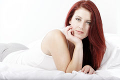 Woman lying on bed Stock Photos