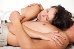 Young woman is lying on his chest man Stock Image