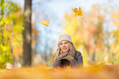 Young woman lying on leaves Stock Photography