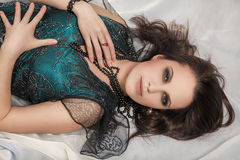 Young woman lying. Luxury young woman lying in bed Royalty Free Stock Image