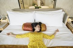 Young woman lying on the luxury bed Royalty Free Stock Image