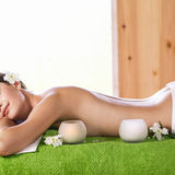 Young woman lying on massage Royalty Free Stock Photography