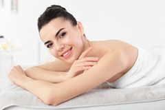 Young woman lying on massage table n spa salon Stock Image