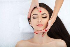 Young woman lying on a massage table,relaxing with eyes closed. Woman. Spa salon royalty free stock photo