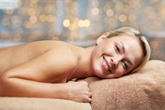 Young woman lying on massage table in spa Stock Image
