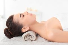 Young woman lying on massage table Stock Photography