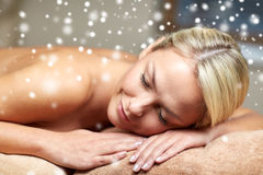 Young woman lying on massage table in spa salon Royalty Free Stock Photos