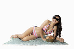 Young woman lying on the mat Royalty Free Stock Images