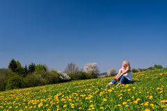 Young woman lying on a meadow Stock Photo