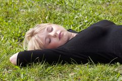 Young woman lying on a meadow Royalty Free Stock Image