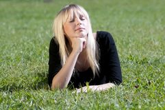 Young woman lying on a meadow Royalty Free Stock Photo