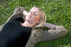 Young woman lying on a meadow Royalty Free Stock Photography