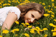 Young woman is lying on meadow. Stock Photo