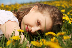 Young woman is lying on meadow. Stock Images