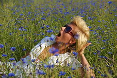 Young woman lying on meadow Royalty Free Stock Photography