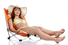Young  woman lying on orange sunbed  Stock Photos