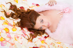 Young woman lying on petals Royalty Free Stock Image