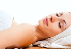 Young woman lying relaxed in the spa Royalty Free Stock Images