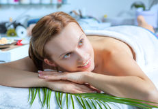 Young woman lying relaxed in the spa salon Stock Image